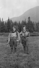Two women on a trek with rifles and cartridge belts (Provincial Archives of Alberta) Tags: alberta canada coalbranch rockymountains mountainpark women guns rifles pistols hunting trekking