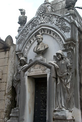 Two angels guarding a neo-gothic tomb (VinayakH) Tags: tombs tomb recoletacemetery recoleta larecoletacemetery cemetery buenosaires graves argentina latinamerica southamerica mausoleum artnouveau artdeco neogothic baroque architecture