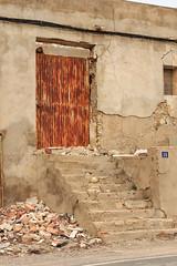 Door and daftness (RagbagPhotography) Tags: torremendo murcia orihuela wilderness spanish door steps mannequin feet rubble ruin deprivation friendly welcoming hola bon dia