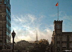 Matin d'automne (Jean S..) Tags: fog misty city urban flag building streetlight sky clouds blue white orange red yellow windows