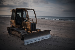 photogenic bulldozer at indiana dunes state park (TheEvillOnes) Tags: activity background backhoe beach beautiful blue bulldozer car coast coastline construction dig digger drive dumper earthmover equipment excavator heavy industrial industry land landscape large loader machine machinery nature ocean road sand sea season site sky spring summer sunset surf track tractor transport transportation truckload vehicle water wave wheel work yellow