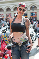 Biker Woman (Ron Scubadiver's Wild Life) Tags: girl woman nikon 50mm texas galveston outdoor lone star rally candid street tattoos denim sunglasses pierced style
