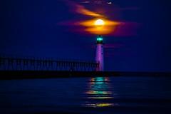 Manistee in the Moonlight (Notkalvin) Tags: manistee northpier lighthouse light navigationalaid notkalvin mikekline notkalvinphotography outdoor lakemichigan moon moonset settingmoon lunar shore clouds supermoon beach