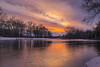 A Sunset Remembered (tquist24) Tags: elkhart indiana islandpark nikon nikond5300 stjosephriver clouds evening geotagged longexposure reflection reflections river silhouette sky snow sunset tree trees water winter unitedstates