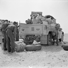 An LRDG Chevrolet 30cwt truck is reloaded after a tyre change, 25 May 1942.