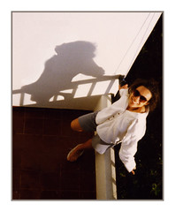 Balcony (theimagebusiness) Tags: old travel winter shadow sun film tourism portugal girl sunglasses europe pretty balcony rail olympus newyear lookingup 1995 leaning whitewall momentintime om2n vivitarseries1 theimagebusiness theimagebusinesscouk
