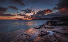 O'ahu Sunset (tobyharriman) Tags: pictures ocean longexposure sunset seascape motion water june canon landscape outside island photography hawaii coast rocks colorful cloudy oahu scenic cliffs honolulu streaks chinawalls tobyharriman