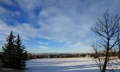 Winter morning (Una S) Tags: city morning blue winter sky sun white snow canada mountains calgary field clouds rockies view soccer rocky ab fluff neighborhood alberta suburbs