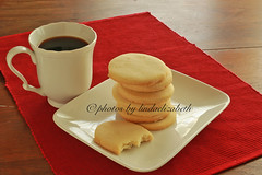 Coffee break (lindaelizabeth) Tags: red white coffee cookies horizontal canon table dessert zoom coffeecup plate stack diagonal placemat shortbread whiteplate coffeebreak whitecup woodentable redplacemat shortbreadcookies rectangularplate browntable shrewsburybiscuits stackedcookies diagonalplacemat