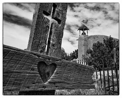 Loved (JUSTBECVZ) Tags: newmexico santafe church graveyard canon site cross tombstone historic adobe 2014 distagon2128ze