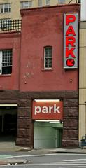 Travelers Garage (TheMachineStops) Tags: 2009 outdoor westvillage nyc manhattan newyorkcity parkinggarage neon sign brick building red photoshop text door