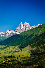Mount Ushba in Svaneti (oleksandr.mazur) Tags: above alpine altitude caucasus cliff countryside crag culture day field forest freedom georgia glacier high hill ice icecap landscape light meadow morning mountain nature outdoor peaceful peak range relax resort ridge rock scenic sky slope snow snowy summer summit sun sunlight sunny sunshine top tourism travel tree vacation view village wall wide
