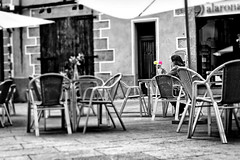...a touch of color (Fnikos) Tags: street people city coffee seat table door touch color flower outdoor