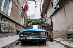 Abandoned (Yoan Mitov) Tags: fuji xt10 fujifilm simulation samyang 12mmf2 sofia bulgaria 2016 back alley street abandoned car moskvich laundry clothes buildings architecture