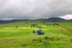 Blue Hawaiian Helicopter (milepost430media.com) Tags: helicopter bluehawaii hawaii blue field volcano tour flight aircraft rotors blades tourism wailea haleakala green grass pasture 70d dslr paradise