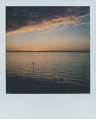Lake Erie Sunset impossible tones (The Stugots) Tags: lake erie presque isle bay front sunset sx70 sx 70 polaroid instant film photography clouds sky nature classic roidweek roid week polaroidweek white frame