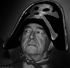 Billy Bones. (Neil. Moralee) Tags: pirate man mature old hat skull crossbones billy bones treasure island panto pantomime black white bw mono monochrome actor village hemyock act scrf neckerchief face close portrait contrast detail neil moralee nikon d7100 18300mm flash strobe