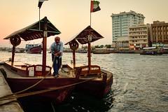 DSC_3054 Drawing In (rabbiv) Tags: d750 nikon boat abra water waterfront creek sunset dubai people ropes