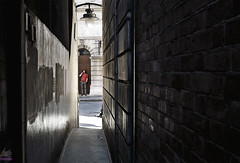 Eye Contact (roijoy) Tags: street red man london shirt alley call phone bricks doorway walls talking passage tee