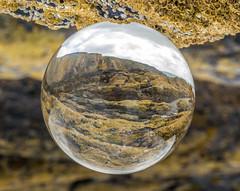 Sea shore (Matt Bigwood) Tags: summer cliff sun beach glass wales ball sand rocks tide sphere coastline rockpools crystall mattbigwood