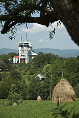 Breb (Michael Baynes Photography) Tags: travel tree church grass europe romania hay maramures breb