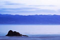 Purple Haze (PatrickJamesPhoto) Tags: ocean california ca longexposure sunset sea sky seascape mountains nature water rock clouds landscape coast outdoor morrobay centralcoast cayucos slo jimihendrix sanluisobispo density neutral purplehaze ndfilter pentaxk10d patrickjamesphoto