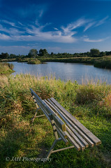 I Go There Alone (jah32) Tags: summer sky ontario canada water clouds bench countryside pond nikon alone skies loneliness conservation wetlands solitary sanctuary fingal elgincounty d7000 fingalairbase