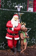 Santa Claus and Rudolph ........just chillin' (Deborah S-C (InTheFairyGarden)) Tags: santa berlin germany posing christmasmarket figurines fatherchristmas santaclaus rudolph colourful lifesize sculptures stnick rudolphtherednosedreindeer berlin~december2013