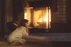(Rebecca812) Tags: christmas wood winter portrait people cute brick home girl childhood fire grate cozy kid fireplace child sweet warmth hearth comfort gaze firewood nightgown christmasstockings canon5dmarkii rebecca812