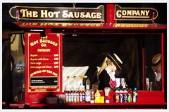 Hot sausage (WanderingAlice) Tags: life street red england woman girl hat photography bath pentax sausage somerset k5 caravane