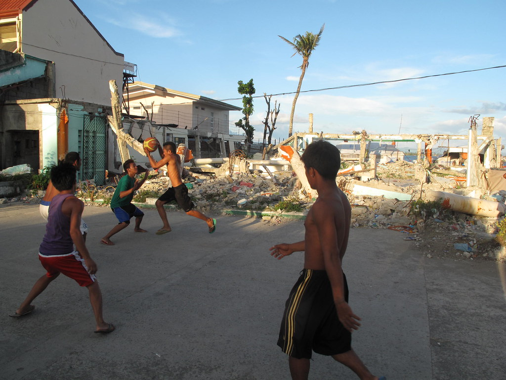 A reclaimed basketball court in Tacloban by DFID - UK Department for International Development, on Flickr