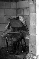 Cold Corner (e.mmacook) Tags: old bw white black broken beer corner concrete bottle chair mess ghost dump jacket forgotten behind left stable stiff gumboots