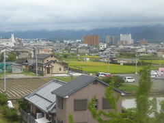 Across the fields to Hineno (seikinsou) Tags: japan spring haruka train jr railway kix kansai airport shinosaka hineno kankuhinenostationhotel field
