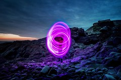 Fantasy (garethleethomas) Tags: clouds sky fantasy neon arty art night nightphotography canon pebbles rocks coast longexposure lighttrails light friend beach poi