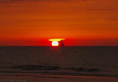 Belgian coast (Natali Antonovich) Tags: belgiancoast northsea sea sunset reflection water nature landscape parallels sky sun wenduine belgium belgique belgie horizon boat