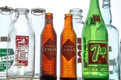 Listen Pal (lori.jane) Tags: antiquemall pop bottle window old 7up glass milk