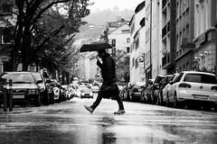 We Move (stefan.bayer) Tags: human move dark white black rain people umbrella man work street stuttgart we wemove