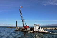 Great Lakes Workhorse (Jan Nagalski) Tags: water pinerivercanal lakemichigan greatlakes lake canal river boat towboat laurieann skiff launch rblyons harbor morning autumn blue flag usflag charlevoix michigan jannagalski jannagal crane equipment constructionequipment lifepreserver