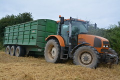 Renault Ares 610 RZ Tractor with a Smyth Trailers Grain Trailer (Shane Casey CK25) Tags: renault ares 610 rz tractor smyth trailers grain trailer orange claas green castletownroche harvest grain2016 grain16 harvest2016 harvest16 corn2016 corn crop tillage crops cereal cereals golden straw dust chaff county cork ireland irish farm farmer farming agri agriculture contractor field ground soil earth work working horse power horsepower hp pull pulling cut cutting knife blade blades machine machinery collect collecting nikon d7100 traktori tracteur traktor trekker trator ciągnik