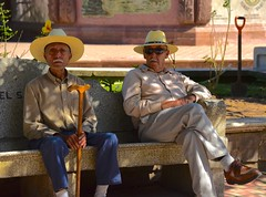 Two Mexican gentlemen, Talpa, Mexico (tvdflickr) Tags: mexico talpa talpamexico candid park square bench man men hombres caballero cane sunglasses hat nikon d750 nikond750 copyright thomasdriggersphotography photos by tom driggers