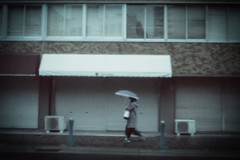 Rainy (tomorca) Tags: umbrella woman street rain pinhole pinholecamera