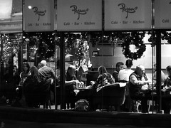 Ryans at night (byronv2) Tags: ryans bar pub cafe restaurant westend queensferryroad newtown scotland edinburgh edinburghbynight edimbourg blackandwhite bw monochrome eating drinking drink winter night nuit nacht peoplewatching candid street seated seat table sitting people sit