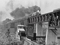 "Southern Railway 2-8-2 4501 soars over the Monongahela River near Monessen, PA, on Pittsburgh and West Virginia tracks that are now part of the Wheeling and Lake Erie,, in 1968. Gritty and grainy, this photo nonetheless was published in ""Trains"" magazine. (Ivan S. Abrams) Tags: blackandwhite newcastle pittsburgh butler bo ge prr ble conrail alco milw emd ple 2102 chessiesystem westmorelandcounty 4070 bessemerandlakeerie steamtours pittsburghandlakeerie ivansabrams eidenau steamlocomtives ustrainsfromthe1960sand1970s"