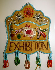 A piece of Indian beadwork on deerskin was made as a souvenir to be sold in the early half of the 1900's at the Canadian National Exhibition.