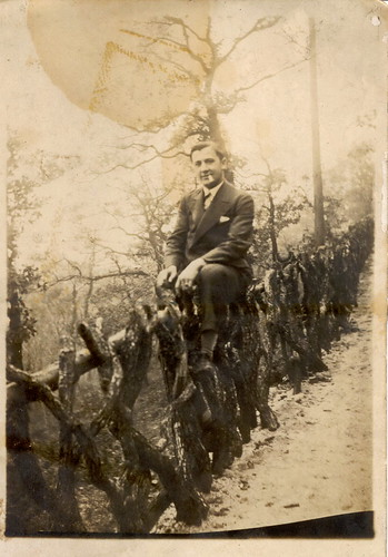 Great uncle Károly sitting on a fence and smoking