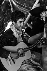 Le musicien du desert (alimhd) Tags: bw music algeria kid tante guitare musicien laghouat