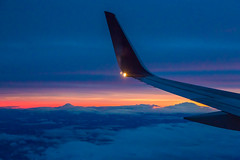 Mt. Adams and Mt. Rainier with Boeing 757 on Approach to Seattle (Lee Rentz) Tags: above winter sunset sky usa cloud mountain mountains clouds america plane airplane landscape volcano flying twilight glow view cloudy aviation flight wing descent aerial blanket layer northamerica glowing volcanoes mtadams mtrainier airliner wingtip viewed mountadams descending