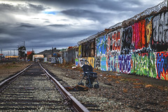 Rock-a-bye-baby (Pixelina Photography) Tags: california urban abandoned rain clouds canon found graffiti oakland garbage cloudy stroller debris traintracks tracks urbanart forgotten urbanexploration sanfranciscobayarea bayarea disused spraypaint eastbay sfbayarea foundobjects graff discarded dslr aerosol filth filthy buggy desolate westcoast deserted aerosolart spraycanart urbanexploring ue graffitiart railroadtracks urbanphotography sprayart oaktown leftbehind throwies americangraffiti thetown rockabyebaby 12ozprophet urbanex westcoastgraffiti oaklandart oaklandgraffiti eastbaygraffiti bayareagraffiti urbanexposure californiagraffiti canoneos5dmarkll eastoaklandgraffiti theinfamousmag filthyfeeds autopsyofamerica pixelina rachelescoto pixelinaphotography spraydaily