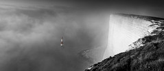 Beachy head mist (JamboEastbourne) Tags: england bw cliff lighthouse mist colour misty sussex chalk head cliffs east isolation punch beachy