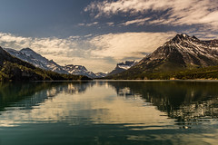 A View From The Boat (murph le) Tags: trees sky lake mountains nature clouds canon reflections boat nationalpark view alberta waterton internationalpeacepark